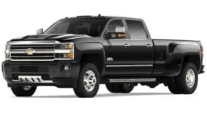 A black 2019 Chevy Silverado 3500 facing the left on white