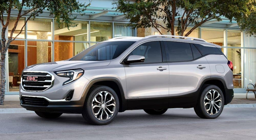 A silver 2019 GMC Acadia in front of a Orlando store
