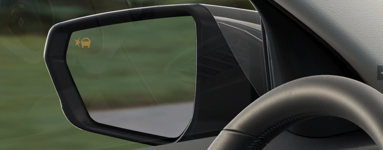 A close up of the mirror of a 2019 GMC Terrain's Lane Change Assist feature.