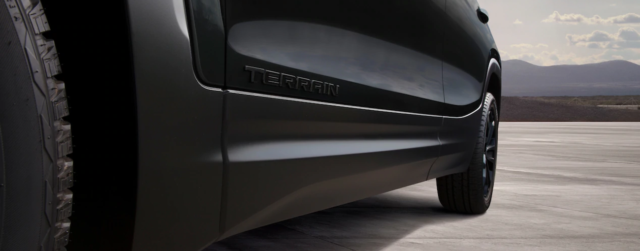A close up of the 2019 GMC Terrain in black's side skirting is shown.