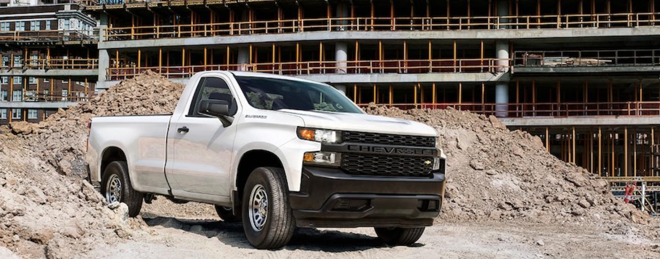 A white 2019 Chevy Silverado navigates a construction site