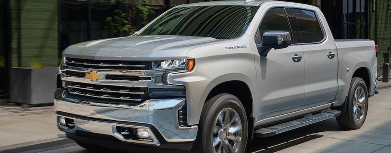 A silver 2019 Chevy Silverado parked outside a local Orlando store