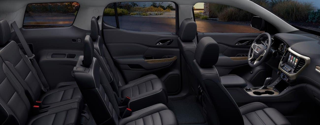 The black, tech filled interior of the 2019 GMC Acadia