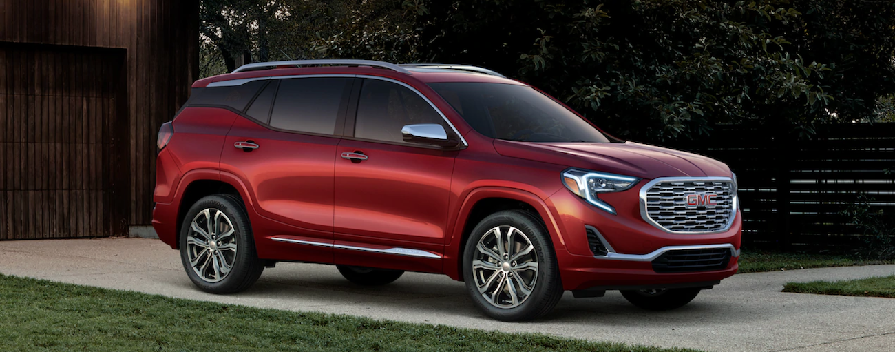A red 2019 GMC Terrain is shown parked in a driveway.