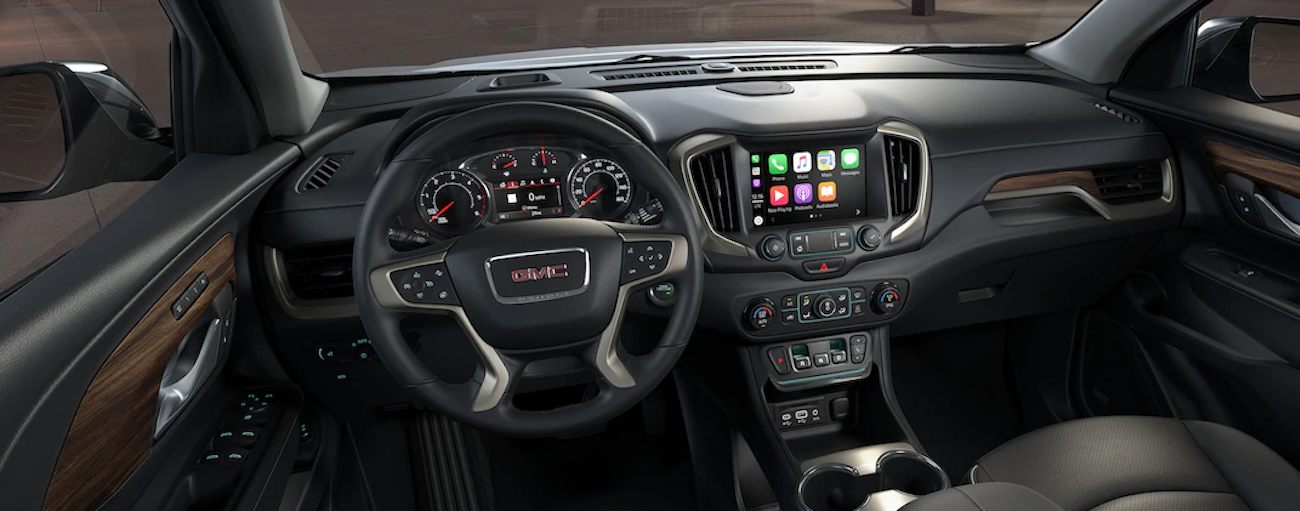 The image shows the black and tan interior features of the Terrain. Compare the technology and features in the 2019 GMC Terrain vs 2019 Chevy Equinox.
