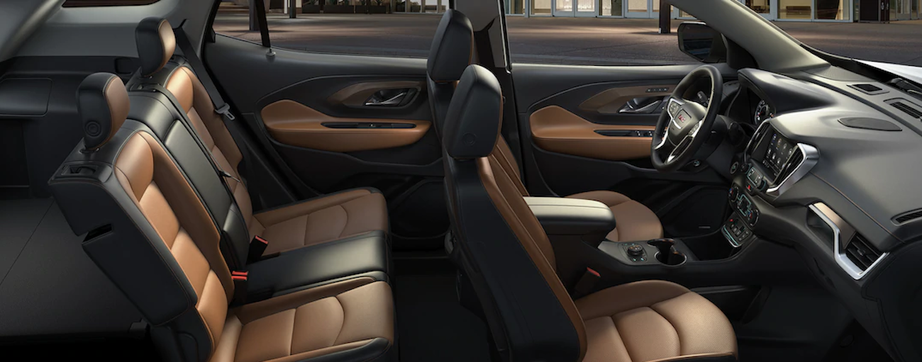 The black and tan interior of this 2019 GMC Terrain shows the interior features when comparing the 2019 GMC Terrain vs 2019 Ford Escape.