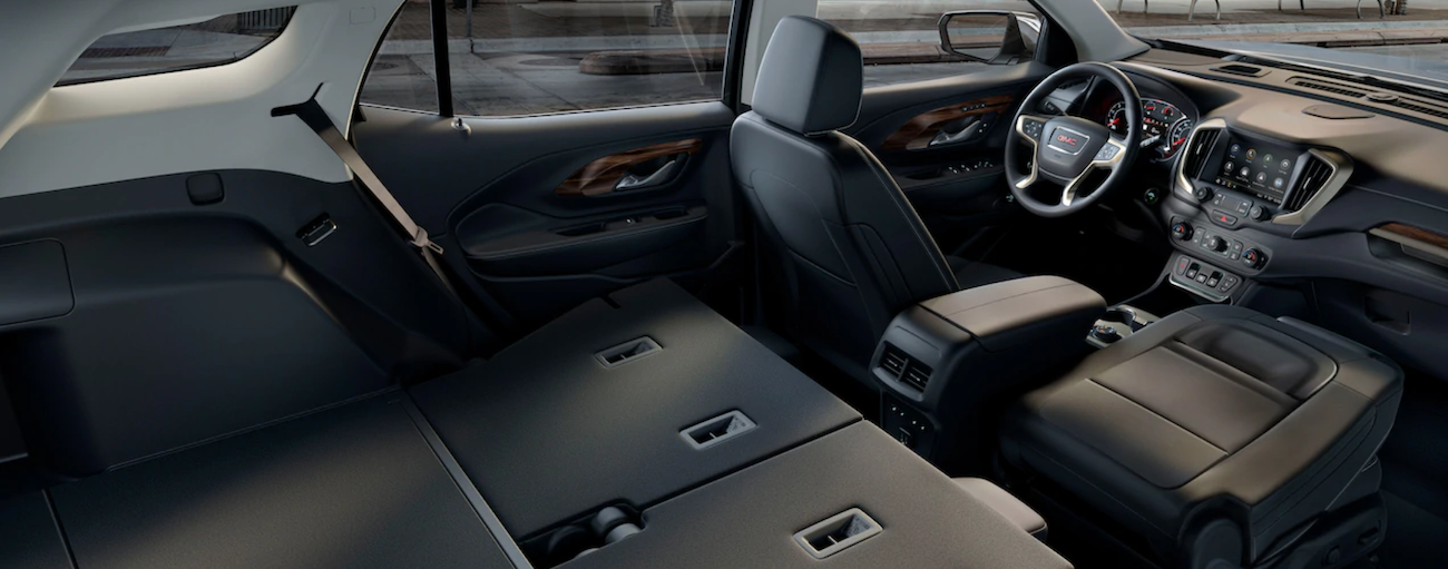 The black interior of the 2019 GMC Terrain is shown with the seats down. Check out other features like available tech when comparing the  2019 GMC Terrain vs 2019 Toyota RAV4.