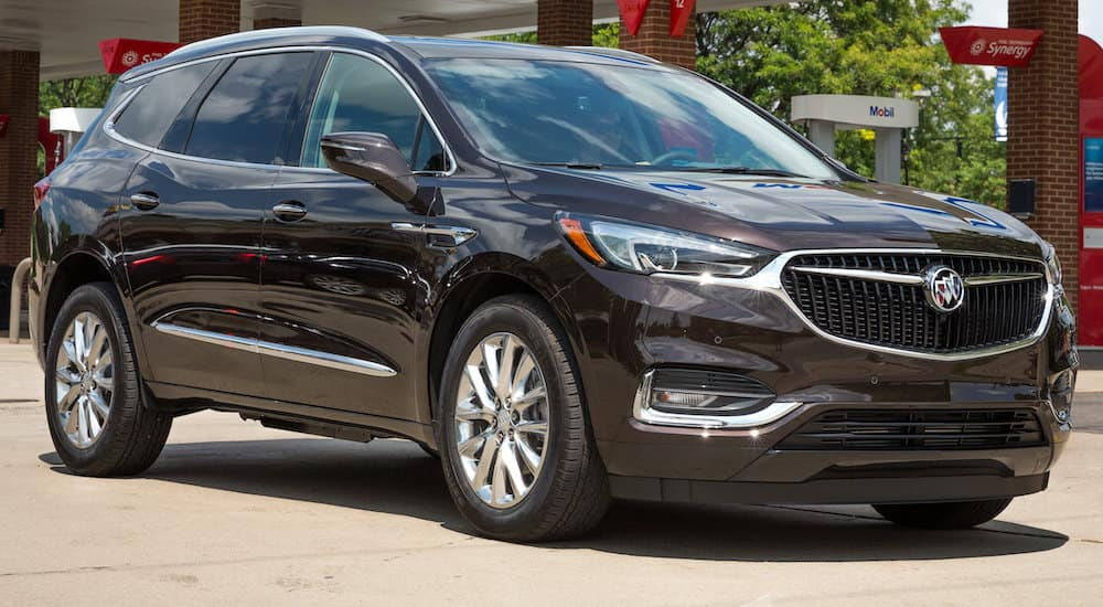 Grey 2019 Buick Enclave parked in front of gas station near Orlando FL