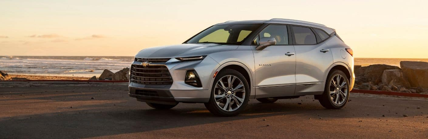 side profile of silver 2019 Chevy Blazer parked by ocean
