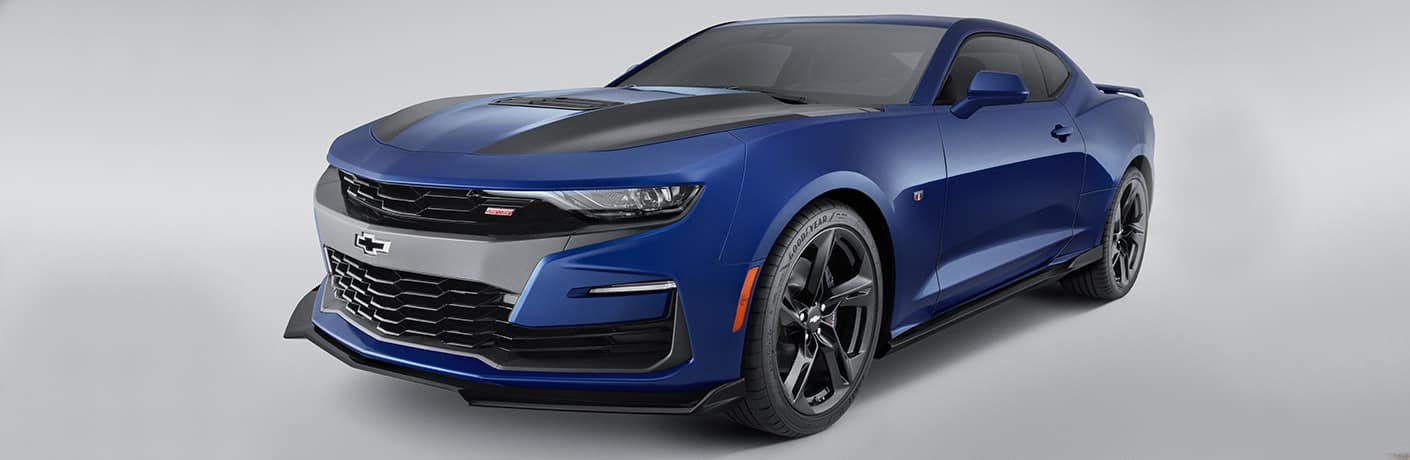 blue 2019 Chevy Camaro parked in empty showroom