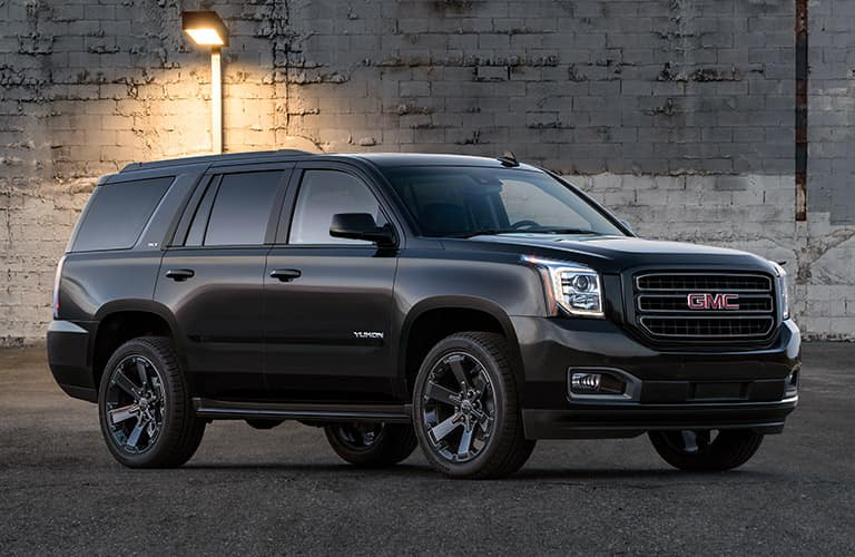 side profile of black 2019 GMC Yukon SUV