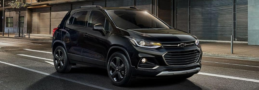 black 2019 Chevy Trax driving down city street
