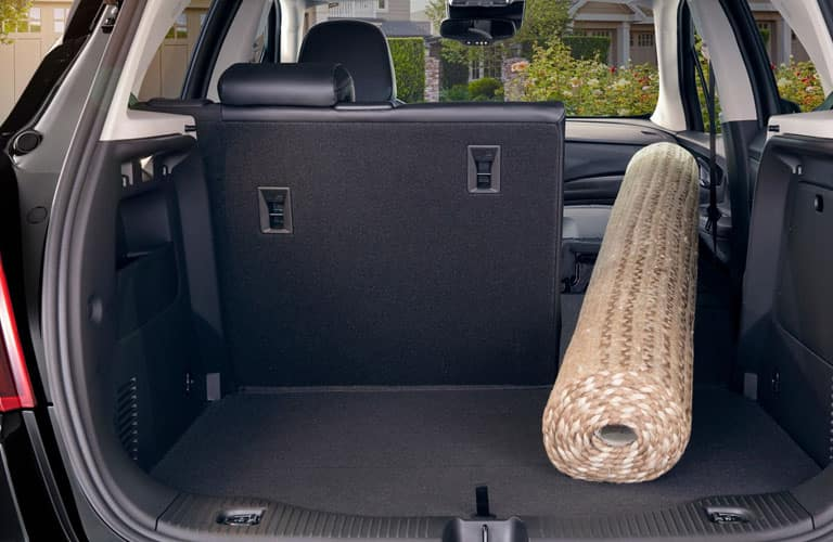 Interior view of 2019 Buick Encore with rolled rug in trunk