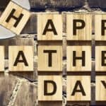 """Happy Fathers Day"" written in Scrabble letters with wrench holding ""H"" tile"