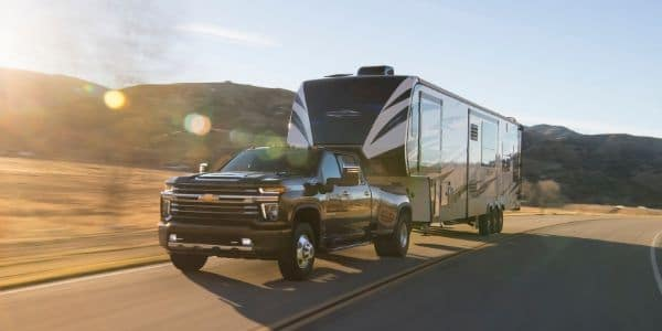 Black 2020 Chevrolet Silverado 3500HD towing trailer