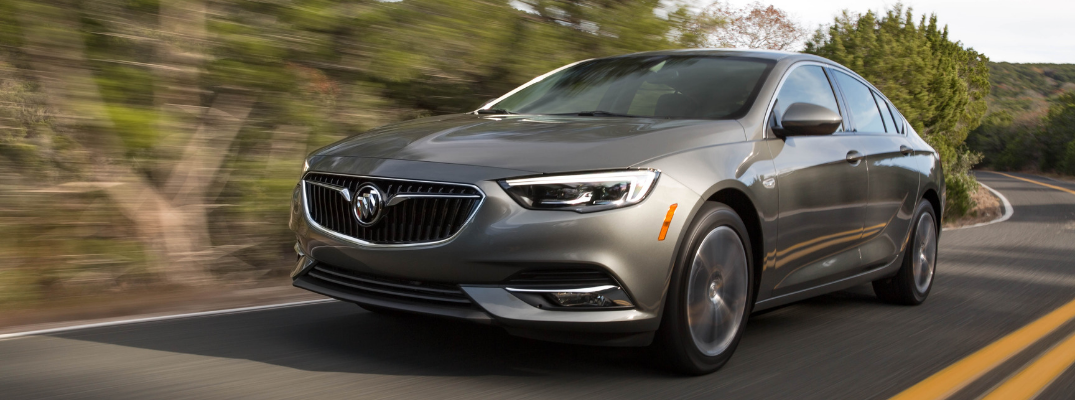 Grey 2019 Buick Regal Sportback driving on road