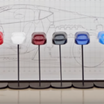Lineup of 12 color examples in front of Corvette drawing