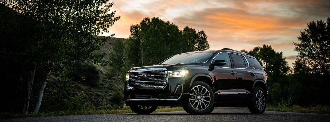 Black 2020 GMC Acadia Denali in front of sunset
