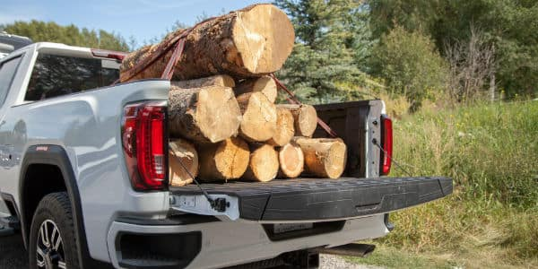 Rear view of 2020 GMC Sierra HD AT4 with bed full of tree cuttings