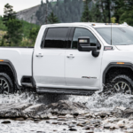 White 2020 GMC Sierra 2500HD AT4 driving through water
