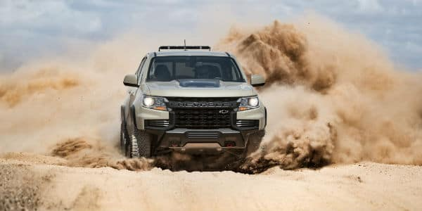 Silver 2021 Chevrolet Colorado driving through dirt