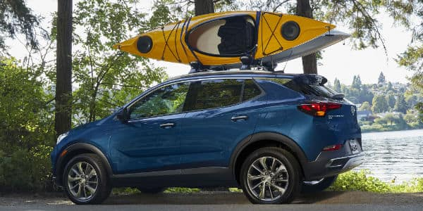 Blue 2020 Buick Encore GX with canoe on roof