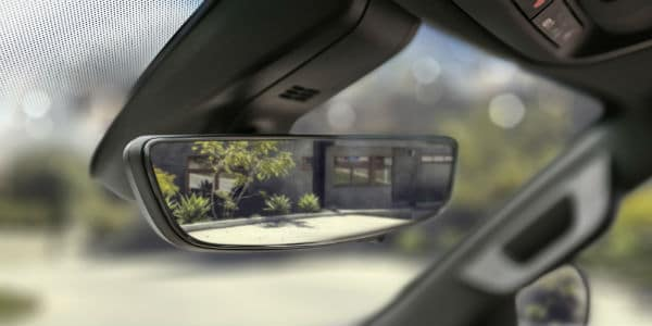 Closeup of rear view mirror in 2021 Chevrolet Suburban