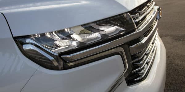 Closeup of headlight on white 2021 Chevrolet Suburban