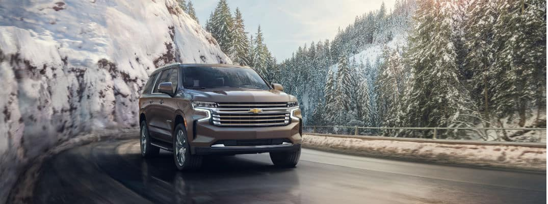 2021 Chevrolet Suburban driving through snowy mountains