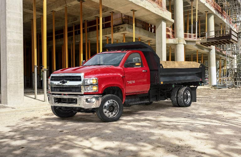 A Medium Duty Chevrolet truck, often mistakenly classed as an HD, a 2019 Chevy Silverado 6500, parked at a worksite.