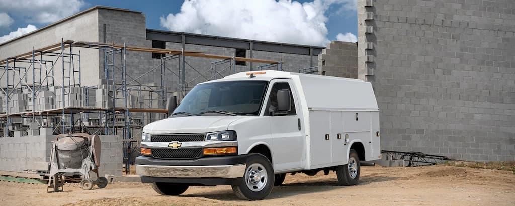 A white 2020 Chevy Express Cutaway parked on a worksite.