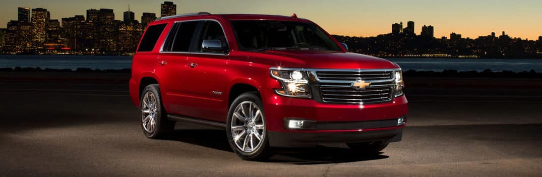 Red 2020 Chevy Tahoe looms before a sunset