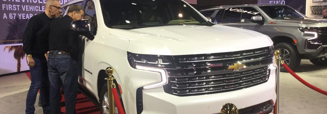 White 2020 Chevy Suburban at the Chicago Auto Show, on a red carpet display celebrating its Hollywood star award