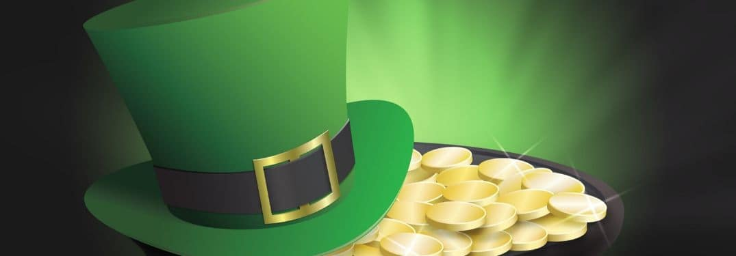 A leprechaun hat and pot of gold reside in a green vortex.