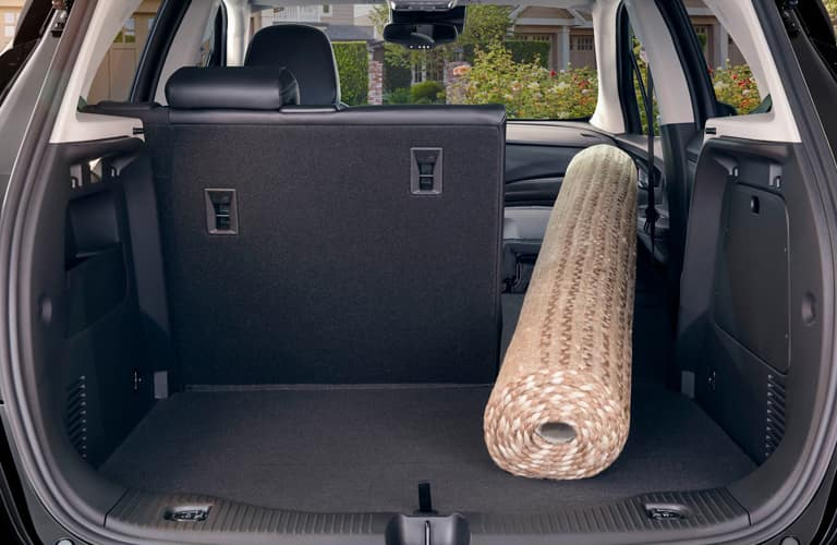 Rear cargo area with a big rug in a 2020 Buick Encore