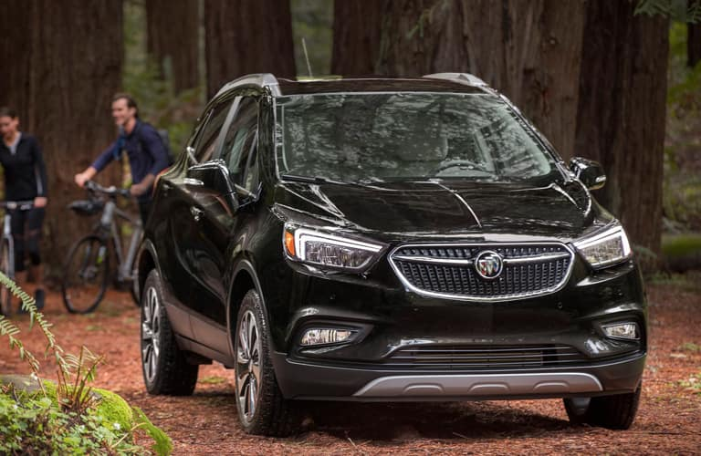 2020 Buick Encore parked in the woods by some bikers