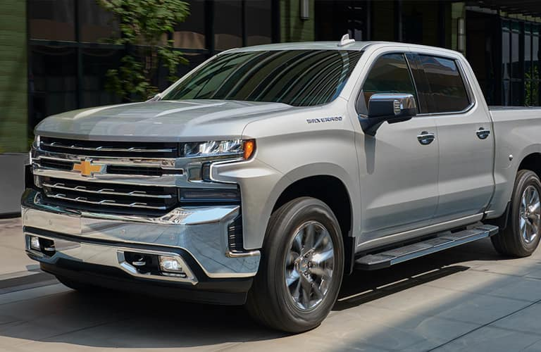 Silver 2020 Chevrolet Silverado parked by the side of a road.