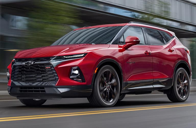 Red 2020 Chevy Blazer drives up a highway.