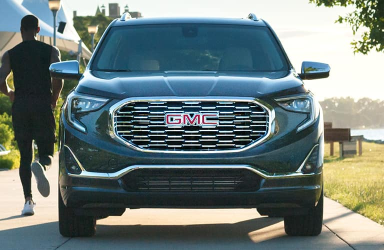 Head-on view of a 2020 GMC Terrain as a man jogs past.