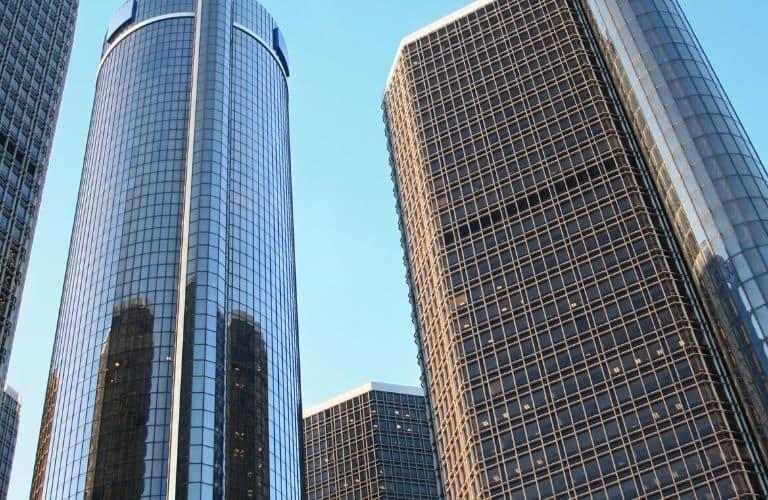 Several buildings of the Detroit Renaissance Center stretch toward the heavens.
