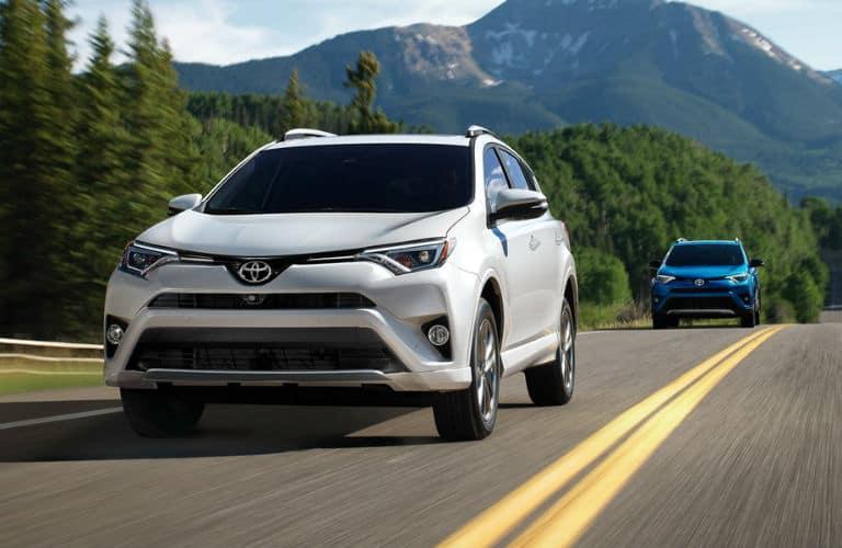 White 2018 Toyota RAV4 rolls along a highway