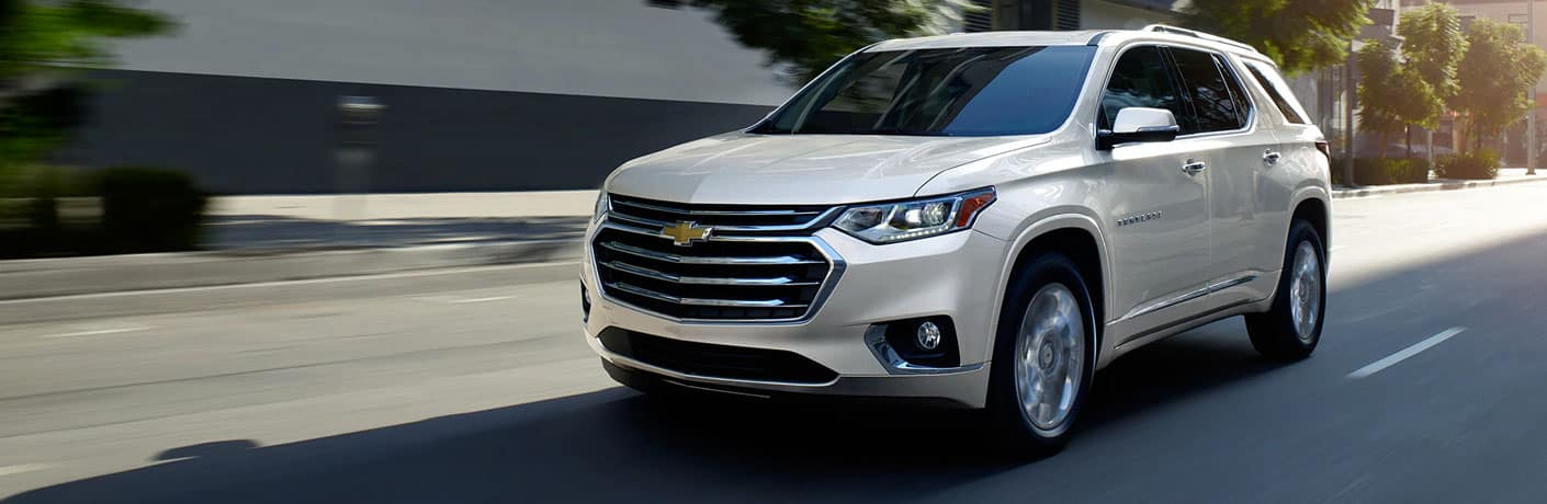 2020 Chevy Traverse drives up a city street