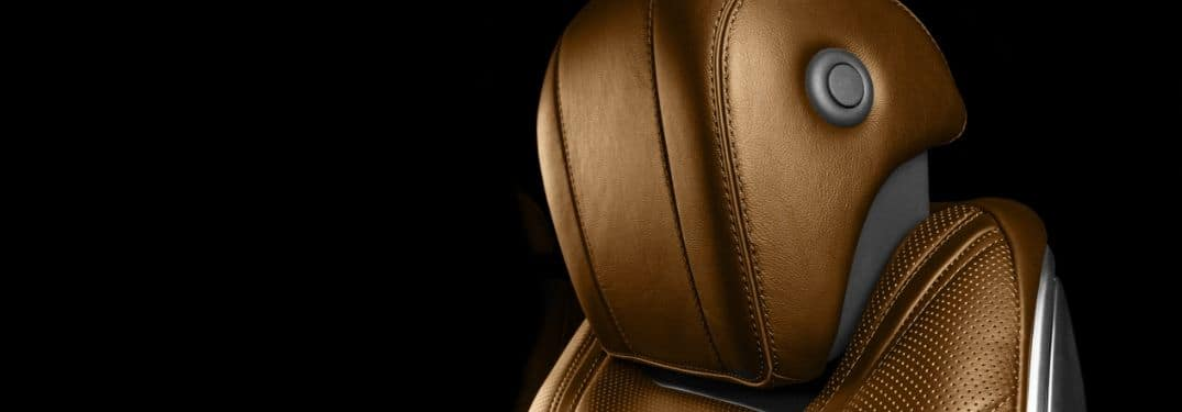 Close-up on a brown leather vehicular headrest.