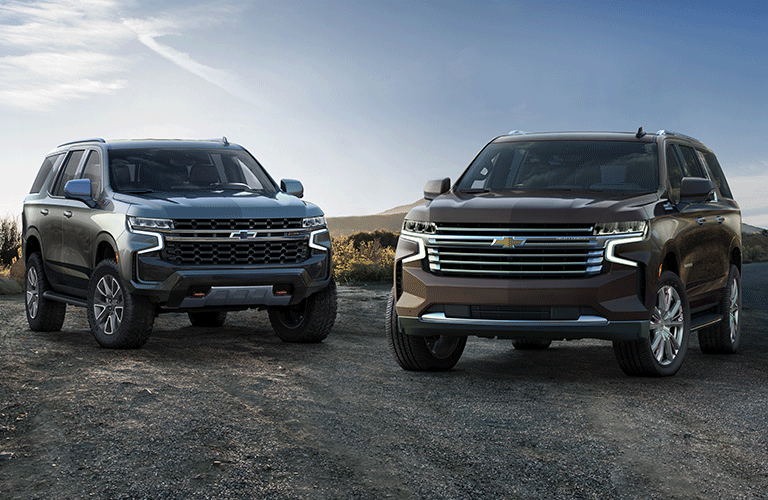 Two 2021 Chevy Tahoe models hang out in a clearing