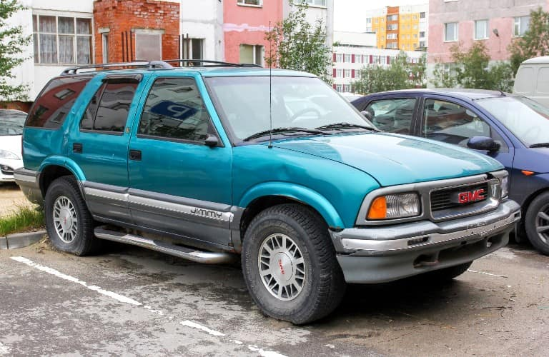 Teal GMC Jimmy in Russia