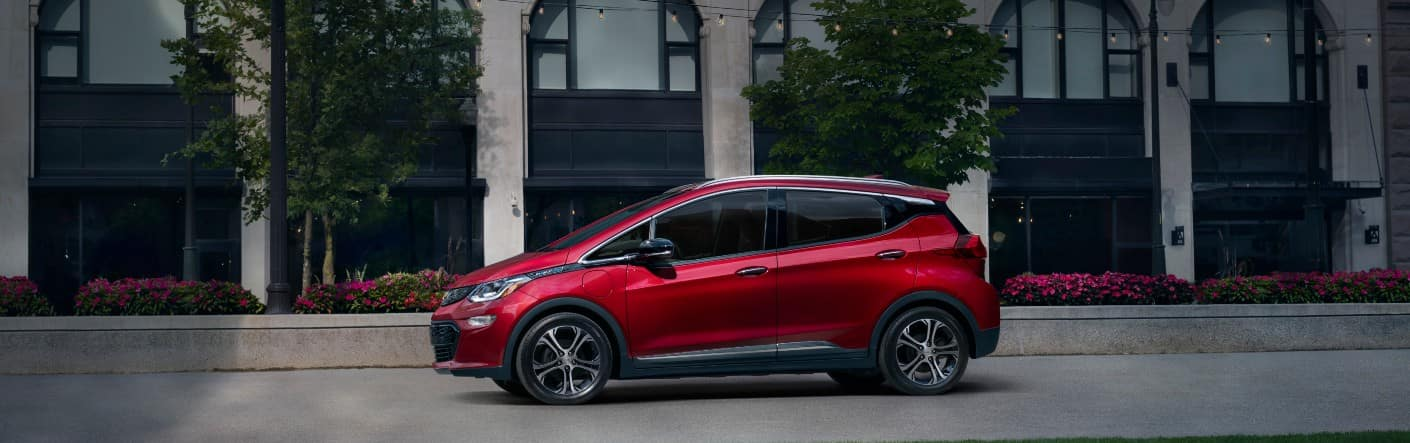 Side view of a red 2020 Chevy Bolt EV