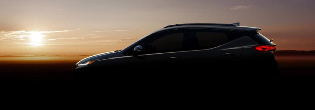 Silhouette of Chevy Bolt EUV against a sunrise