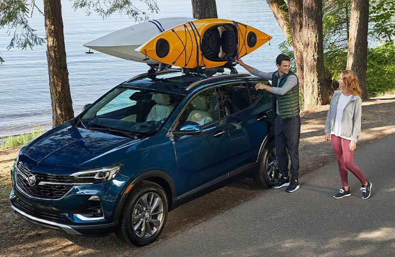 Man shows off how he put kayaks on top of his 2021 Buick Encore