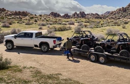 White 2021 GMC work truck hauls a trailer