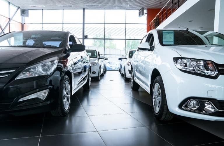 Cars sit inside a showroom